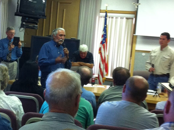 Willie Grayeyes address open house in Monticello. Congressmen Bishop and Chaffetz listen in background.